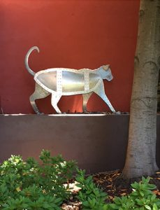 "Photo of Ken Kalman's sculpture ""Cat."" Artwork depicts an aluminum cat."