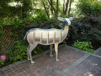 "Photo of Ken Kalman's sculpture ""Deer."" Artwork depicts an aluminum deer."