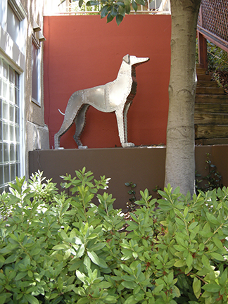 "Photo of Ken Kalman's sculpture ""Greyhound 2"" Artwork depicts an aluminum greyhound dog."