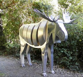 "Photo of Ken Kalman's sculpture ""Moose"". Artwork depicts a large aluminum moose."