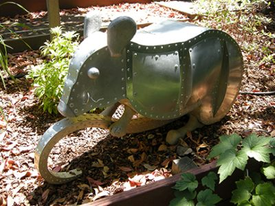 "Photo of Ken Kalman's sculpture ""Mouse."" Artwork depicts an aluminum mouse."