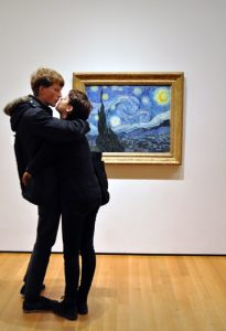"""Photo of Richard Nagler's photograph """"Van Gogh, Starry Night New York Museum of Modern Art.""""  Artwork depicts a couple embracing in the museum in front of Van Gogh's Starry Night painting."""