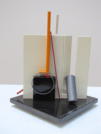 """Photo of Fletcher Benton's study for a sculpture """"Plate Maquette No. 52."""" Artwork depicts an abstract sculpture made of a variety of shapes (square, ring, cylinder) and colors (black, white, silver, red, orange)."""