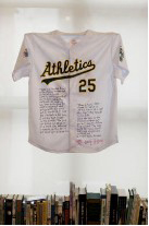 """Photo of Barry Gifford's """"Mark McGwire Jersey."""" Artwork is an Oakland A's jersey for McGwire, number 25, with a poem about McGwire written on it."""