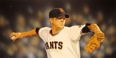 """Photo of Arthur K. Miller's painting 'Mr. Perfect: Matt Cain, June 12, 2012."""" Artwork depicts a photorealistic Matt Cain pitching. Background is the blur of fans in the stands."""
