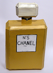 "Photo of Libby Black's sculpture ""Chanel No. 5."" Artwork depicts a bottle of Chanel Number 5 perfume."