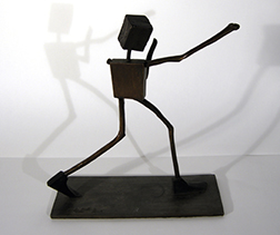 "Photot of Gordon Cook's sculpture ""Shadow Boxer."" Artwork depicts a stick figure boxing."