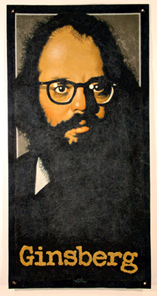 """Photo of Arthur K. Miller's mixed media banner """"Ginsberg."""" Artwork depicts a bearded Allen Ginsberg with his last name written below."""