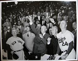 Photo of Osvaldo Salas's photograph of President Eisenhower throwing the ball at the 1956 World Series.
