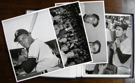 "Overview Photo of Osvaldo Salas's photographs ""1949-1956 Baseball Icons Portfolio."" Artworks depict famous American baseball players and baseball scenes."