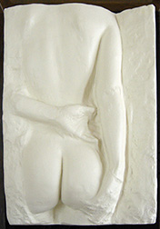 "Photo of George Segal's sculpture ""Gazing Woman."" Artwork depicts the back of a nude woman one arm crossing her back."