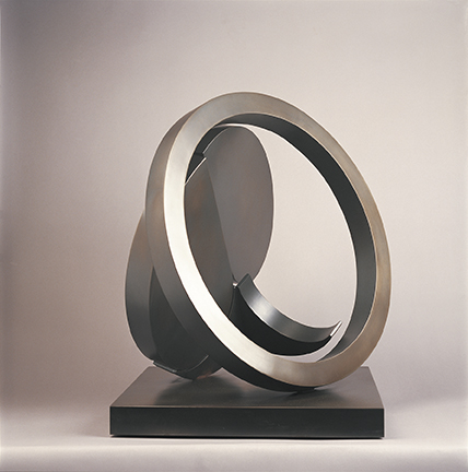 """Photo of Fletcher Benton's sculpture """"Folded Circle Ring Marilyn."""" Artwork depicts metal folded circle balanced with a metal ring."""