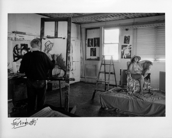 "Photo of Chris Felver's gelatin silver print ""Ferlinghetti with Model."" Image depicts Lawrence Ferlinghetti painting a nude model in his studio. Ferlinghetti's back is to the photographer, the model sits in a chair. Signed by Lawrence Ferlinghetti."
